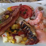Shrimp, tuna, lobster tails, salmon, and seafood ceviche.