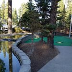 Mini golf, basketball & tennis courts and one of the picnic areas by the kids play toys