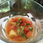 A few ouncez of gazpacho served awkwardly in a small glass