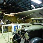 Ansett's Fokker Universal alongside a Studebaker similar to Ansett Motor's first service car.
