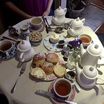Proper table with tea for four
