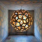 An artistic light fixture in the hallway.