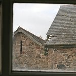 View from bathroom window, white doves/pigeons flying into a loft