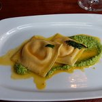 Summer on a plate - carrot ravioli with smashed pea puree.