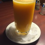 Fresh squeezed orange juice-Love the lace paper doily!