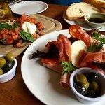 Delicious bruschetta and antipasto meats platter.