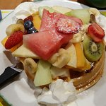 Cereals and Waffle with mountain of fresh fruits