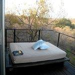 Bed on the room balcony at Singita Lebombo Lodge