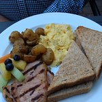 Two eggs with peameal bacon, potatoes, toast