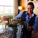 Charming Cara pouring a complimentary glass during Vino hour!