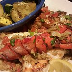 Shrimp, salmon and lobster tail at Red Lobster with grilled zucchini and rice.