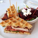 Chicken sandwich with waffle instead of bun and delicious beet salad.