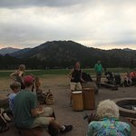 drum circle with travelers of all ages having a blast