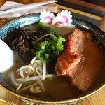 Shoyu (soy-based) tonkotsu with added mushroom and greens instead of bamboo shoots.