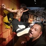 Wax figure of Bruce Lee with me goofing around for a great photo op.