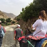 Jennifer riding Muhammed's mule.