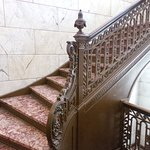 Beautiful red marble stairway inside building.