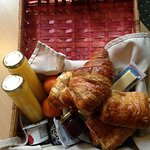 The breakfast basket we got in the morning with real juice and fresh croissants.