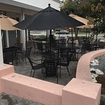 A large patio seating area that covers two sides of the business.