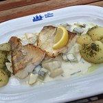 fish, cucumber sauce and potatoes