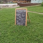 Street-side signage for Chipper Fish in Hoonah, AK