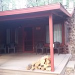 Front porch of our cabin, two bedrms, kitchen w/amendities, dining rm, living w/couch, TV, Firep