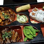 Bento Box with Teriyaki Steak and Spicy Chicken with a Spicy Tuna Roll