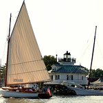 """Hoopers Strait Lighthouse behind 1926 sailing yacht """"Selina II"""", left, and """"H. M. Krentz"""", right"""
