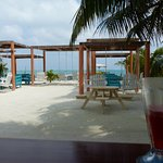 From the open air bar. Strawberry daiquiri! Road that runs aroung the island is between us & tab