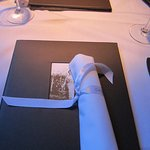 Your menu and napkin awaits you at Cache Cache