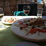 Olives, anchovies, tomatoes, homemade bread, Grk (white wine) and fabulous red prošek