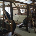 The cloths being woven by the weavers in the workshop.