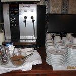 Coffee machine, sugar, coffee spoons, cups