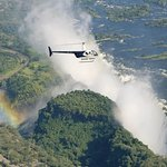 Flying over the mighty Victoria Falls with a Helipad ride on a tour extension