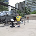 Standing next to a full sized combat chopper, on the roof of the Museum.