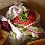 Tandoori chicken on top of fresh salad.