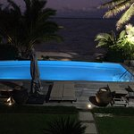 Nighttime view from Villa 5 overlooking the pool.