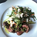 Hangar steak with chimichurri sauce and arugula, asparagus, feta salad