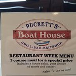 Puckett's Boat House sign on table