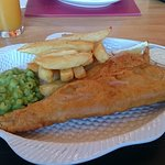 Adnams beer battered haddock chips and mushy peas.