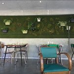 The green plant wall, we were seated in the sofas facing it.