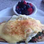Eggs Benedict - English muffins, veggies, Ham, perfect poached egg & Hollandaise sauce.