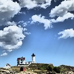 Nubble lighthouse with fluffy clouds