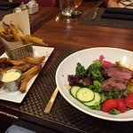 Chopped salad with steak and french fries