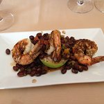 Shrimp with grilled avocado and black bean appetizer