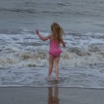 My daughter loving the sea.