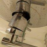 The broken bathroom shower tap