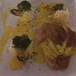 Red snapper fillet with mussels and saffron creamy sauce, broccoli and mashed potatoes. So. Good