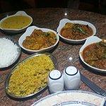 Boiled rice, veg pilau, aloo gobi, bindi bhaji, tarka daal and brinjal