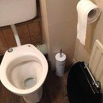 Broken toilet seat in our room